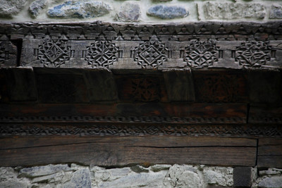 The intricate carvings around the door frame.