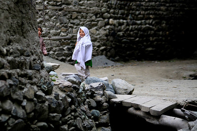 Anisa took this picture.  The two girls were playing hide and see with her.  Every time she would raise the camera they would run around the corner and then peek out again.  This the town of Shigar.