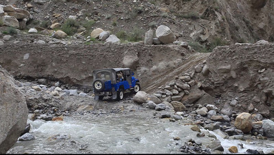 VIDEO - The lead jeep tries to roar through the ford but then has to engage 4 wheel drive to go up the other side.