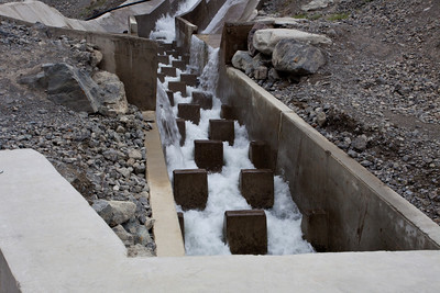 Breakers slow the water down.