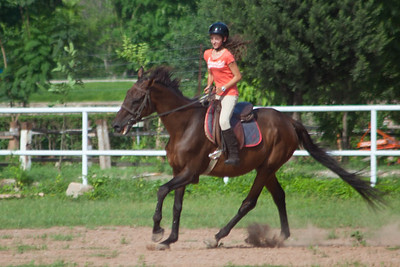 The instructor was very impressed by here even though she lost her stirrup in this picture!