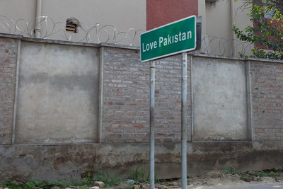 Matthew liked the exhortations on the streets of Pindi, here outside a compound with barbed wire.