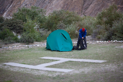 Rich and Tanya's tent goes up on the helipad.