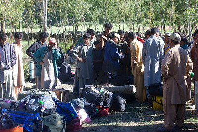 Khalil takes down the names and picks the porters.  His job as Head Porter was to keep order and make sure the porters were treated equally and fairly.  This was seconds before the riot when the waiting crowd all ran in and grabbed bags and tried to take off.  Immediately Khalil was swinging his pickaxe to restore order.
