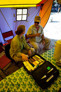 Linda goes though the medical bag that she had stocked up in Rawalpindi with Saadia's help.  Their selection proved to be very useful.  The entire bunch of medical supplies was no more than Rs 6000/-.  Ayub chats with Linda in the mess tent.
