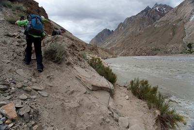 Anisa scrambles over a detour because the lower path had been washed away.  An earlier party had taken the wrong path, found themselves in the washed out area and tried to leap accross boulders and almost ended up losing a person in the river.