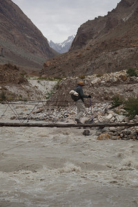 Matthew crosing the bridge at Jhula.