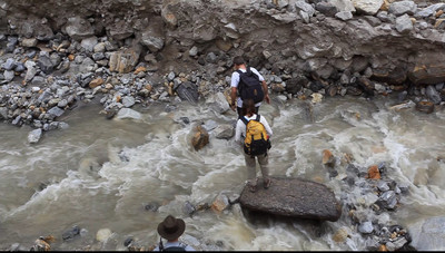 VIDEO - Tanya crosses a stream.  She said she always took a helping hand if it was offered.