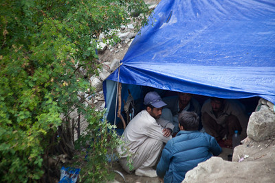 The porters use tarps for shelter and crowd under that.  Some have rugs to sleep on, others just plastic sheets.