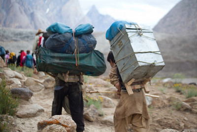 Porters carrying Expedition 59 equipment.