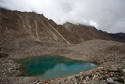 You would run into these glacial ponds.  Matthew thought there was some copper to make them so green.