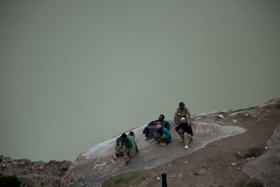Another group of porters find a rock lower down.