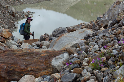 Anisa navigating around a glacial lake.