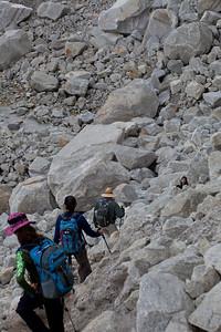 A downhill spot through a boulder field.