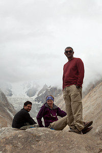 Three of the resting humans.  Ignacio, Erin and Adil settle down on the giant rock at the Urdukas campground.