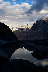 The sunrise progresses at Urdukas Camp looking over the glacial lake wit the Trango Towers and Ulli Biaho in the background.