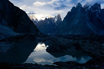 Dawn at Urdukas Camp looking over the glacial lake wit the Trango Towers and Ulli Biaho in the background.