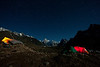 Another night shot.   The porters shelter is on the left while the right has our tents.  Masherbrum is in the back.  Since the exposure has to be so long to get the light, the stars show up as streaks instead of dots.