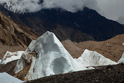 pyramids of snow jutted out of the Baltoro in this stretch.  These would dwarf a person if they stood next to them.