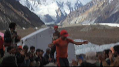 VIDEO - Dancing celebration in front of K2.  Ibrahim, who bacame a good friend over the course of the trip does his usual kung fu dance to the delight of the crowd.