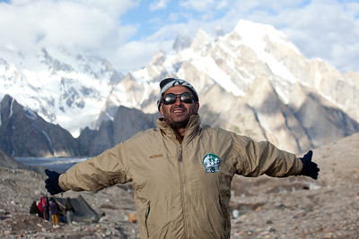 Adil stretches in the morning sun in front of Masherbrum...ready to take over Concordia.