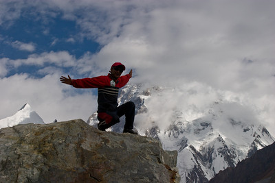 While we were catching our breath, Ibrahim got bored and climbed this large boulder for a better view.  K2 in the background.