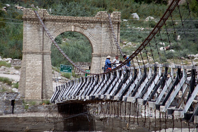 The first jeep crossed the bridge.