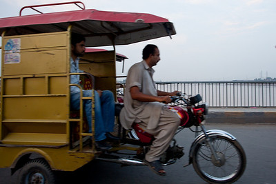 Another rickshaw goes by.