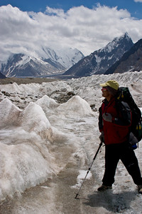 Khalil on the glacier with Mitre Peak and Chogolisa in the background.