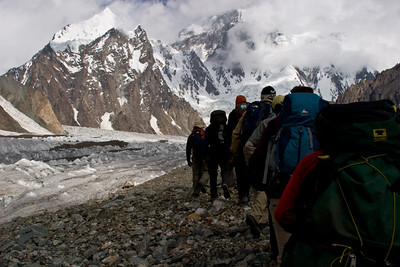 The group following the path, K2 and Angel Peak in the background.