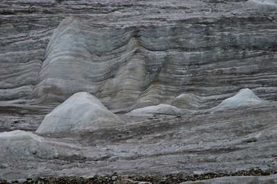 Glacial ice formations.  There is little sense of scale here, but those stones at the bottom of the picture are about the size of your head.