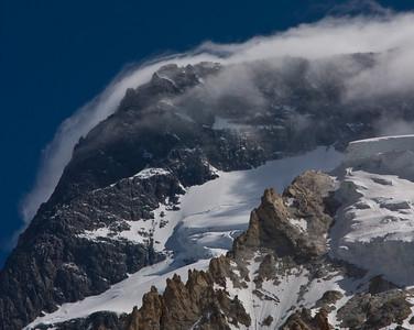 Clouds blowing over part of Broad Peak.