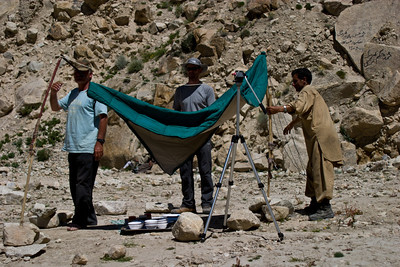 The day was getting exceedingly hot, easily in the 90's.  The worst was the lack of wind.  It seemed the sun was just beating down on you.  We stopped for lunch at Liligo, and Zahoor helped set up an impromptu sun shelter using a couple of walking sticks and Dad's tripod.