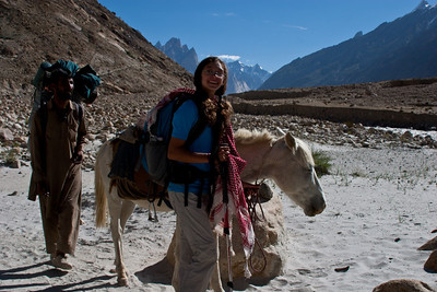 """Anisa has made a friend of the white pony, which she named """"Burraf.""""  She was always excited when she got to lead him.  We had taken all of the packs off the pony so that he would be ready to carry a human load, in case someone couldn't finish the hike."""