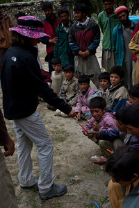 Anisa hands out pens and pencils to the boys.  They are asked if they have sisters, and get extra to give their siblings that are back home.