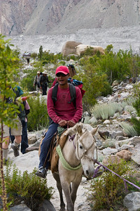 """After lunch, Ibrahim gets to ride on a horse, since everyone was feeling much better and no one needed to ride.  Really, it was more of a pony.  But this is his first horse ride ever, and he was very excited.  So we will say """"horse""""."""
