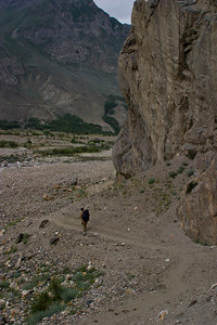 Murad leads by example, waiting for us slow foreigners to catch up.  We are making our way back down into the more fertile parts of the valley now, and we can see the first of the villages across the river.