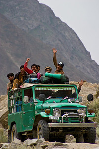 The porters and staff in the baggage jeep, having a great time as we start off down the road back to Skardu.