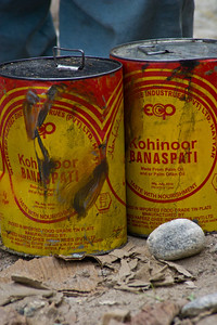 """Cooking oil waiting to go up the mountains.  """"Taste With Nourishment."""""""