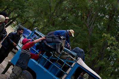 Everyone, particularly Ibrahim and Ignacio, get really into it and as the tempo picks up, throw stuff to Khalil faster than he can store it.  Eventually a laughing Khalil is just being pummled by bags.  But we sure got that jeep loaded up quick.