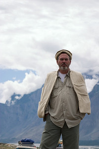 Matthew, in mountain regalia, against a mountain backdrop.