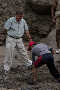 Ayub, our Mountain Guide, in his button-down and khaki's, supervising the staff's road-building tactics.