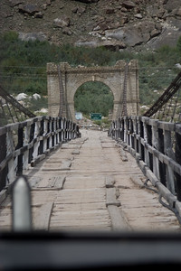 And get ready for our first wood/steel-cable suspension bridge.  The whole span undulates as the jeeps rolls across, the wood creaking underneath, and the river roaring away beneath that.  Not the most settling experience.