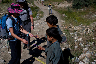 """As we near Askoli, we run into a couple of kids from the town.  Anisa has brought along pens to hand out along the way, and has really been looking forward to this.  Sure enough, as we pass, the kids ask """"Pens?  Pens?""""  And Anisa flies into action."""