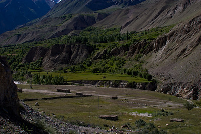 Across the river lies Korphe, the town where Greg Mortenson was rescued and subsequently started his school-building in the area after his failed K2 attempt.  From Three Cups of Tea.  You can just barely see the uprights of the suspension bridge he built across the river.