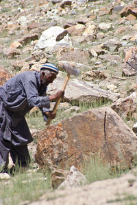 Further outside of town, this guy was hitting a rock with a hammer.  We weren't quite sure what he was doing, but he really liked posing for pictures.  Apparently he was breaking rocks for use in building houses.