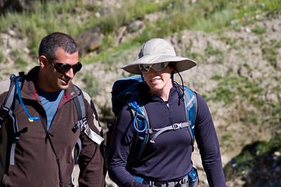 Adil and Erin hiking in the sun.