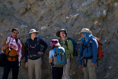 The group takes shelter in the shade of a ravine.