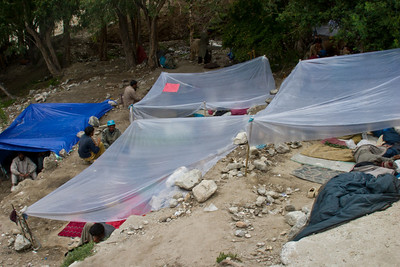 With the rain clouds rolling in, the porters slept under these plastic tarps.  You can see their sleeping pads, blankets and sleeping bags.  They made due with remarkably little, which is a little embarassing to all of us, who were sleeping in our fancy tents and nice down sleeping bags.