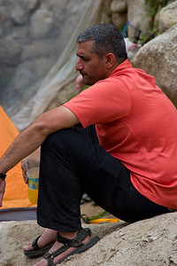 Adil rests at Paiju, and enjoys a waterbottle full of Tang.